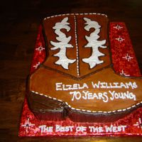 The Best Of The West Western Boot designed in buttercream icing colored brown for both boot and sole of shoe. White icing for decal and stitching.