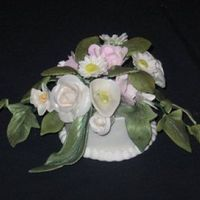 Topper Cake topper for wedding cakejust posted . All gumpaste flowers with gumpaste holder. Holderborder royal icing.
