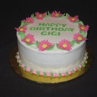 Gigi's Daisies last minute cake for a friend. She told me to just ice it and write happy b-day. No way I could do that so just gave it a daisy border.