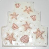 Seashells Wedding Cake Cookie These large wedding cake cookies were made for a beach-themed wedding.