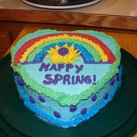 Happy Spring Cake   My attempt for the first cake in Wilton Course 1. I used the rainbow template with piping gel.