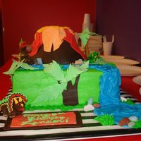 Dino Cake Buttercream with fondant accents. Volcano was rice krispie. Client took photo, so it looked better in person. Inspiration from this site of...