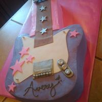 Hannah Montana Guitar I did this cake for a girl turning 9 years old. It was covered in butter cream with fondant accents. I would love to do it again all in...