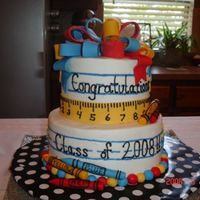 Preschool Graduation Buttercream and fondant accents...took inspiration from serveral cakes on cc. Cake was chocolate and vanilla layers with fudge oreo filling...