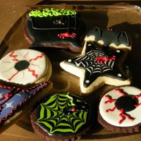 Halloween Cookies 08 Sugar cookies and chocolate sugar cookies w/ RI. Some ideas from others off of this site! Thanks.