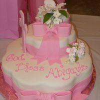 Baby Shower / Baptismal This was for a combo Baby shower , Baptismal cake for my husbands god child. the bottom layer is white cake with lemon cream filling. The...