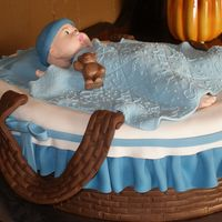 Moses Basket   Baby is made out of fondant, White cake covered in fondant