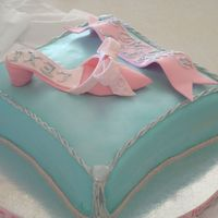 Shoe And Pillow Cake This is my first shoe and pillow cake.I wasn't able to shape the bottom of the pillow so may be next time.Overall i'm pretty...