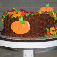 Fall Birthday Cake  I made this cake for my mother-in-law's birthday last November. It's a variation of the Wilton Course II graduation cake. The...