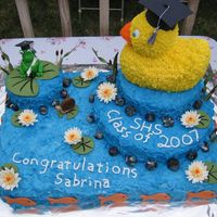 Duck Grad Cake  My sister collects rubber duckies so I made her a duck graduation cake... complete with a pond! The sheet cake is half chocolate/half...
