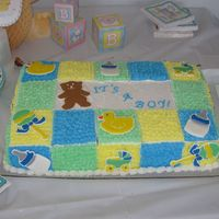 Boy Baby Shower  This was for my cousin's baby shower. The cake is marble cake with milk chocolate frosting filling, buttercream, and color flow...