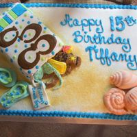 Beachy Birthday Cake Buttercream frosting with MMF accents. first attempt with the MMF. but the Birthday Girl loved it and that is all that counts.