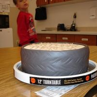 "Tire Cake  This was supposed to be a ""Harley Davidson"" birthday cake, but my colorflow logo broke, so I just wrote ""Harley Birthday&..."