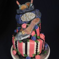 Makeup And A Shoe I made this cake for my little sis who is now 29. This is my first attempt to do a shoe, I need more practice. The cake is covered in MMF....