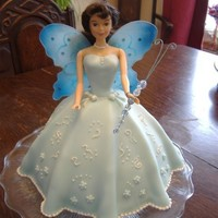 Fairy Princess fondant covered with bought wings and 'wand'