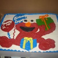 Elmo Birthday Cake I made this cake for my nephews 2nd birthday. His dad drew the Elmo out for me and I made a copy of it cut it out and traced it on the cake...