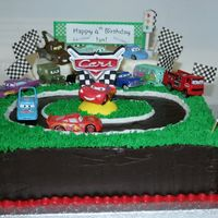 Disney Cars Racetrack I made this cake for my son's fourth birthday party (a Disney Cars theme, can you tell?). The cake is two layer 9x13, iced in dark...