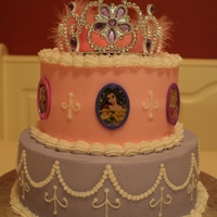 Princess Cake The princesses are actually toy jewelry (rings) pushed into the sides of the cake. Tiara is plastic :)
