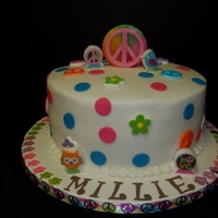 Hippy Chick   10in round yellow cake with buttercream icing. Royal icing accents