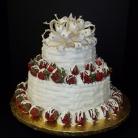 Strawberries And Cream   10in/6in Red Velvet Cream Cheese filling Buttercream with Basketweave design. Gumpaste bow