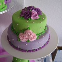 "Purple And Green This was on a 3 tiered stand with minicakes on the other 2. 8"" and 6"" Chocolate cake w/ganache filling and buttercream under..."
