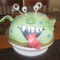 "Monster Cake 10"" round vanilla cake w/cookies and cream filling. Carved and covered in vanilla buttercream & homemade fondant. Fondant &..."