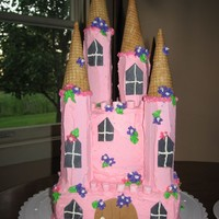 Princess Castle For my daughter's first birthday! White cake, frosted in BC, door and windows are fondant. This was my first attempt at a castle cake...