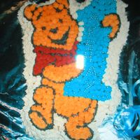Winnie Pooh I bake this cake for my son first birthday ,it is buttercream icing.