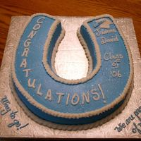 Congratulations! This is for an elementary school graduation. The school colors are blue and white, and their mascot is the Stallion. This is why the...
