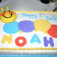 Happy 1St Birthday Noah Baby Einstein caterpillar was requested. The head is a small cake covered in fondant. The body is just buttercream icing.