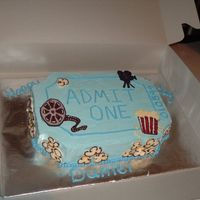 Movie Ticket  My friend was hosting a movie party for her son's birthday and we came up with this idea for a cake. Cake is covered in buttercream...