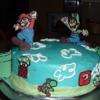 Matt's Mario Cake Carrot cake with cream cheese icing and filling. Characters are chocolate transfers.