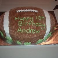 "Football Cake  The football was carved out of a 11x15 pan and then iced in chocolate flavored IMBC. All the little dots took forever, but ""Andrew&..."