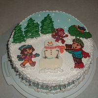 Winter Dora Birthday Cake   Cake is iced in IMBC and the characters and trees are freehanded from candymelts. Thanks for looking!