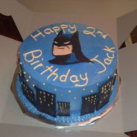 "Jack's Batman Cake   9"" Chocolate cake with oreo filling and IMBC. Batman and the buildings were chocolate transfers."