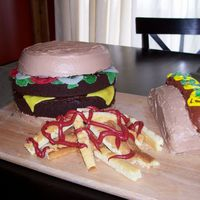 A Double Cheeseburger, A Hot Dog And A Side Of French Fries This was my son's 2nd birthday cake and my first attempt at cake decorating. With a little more experience the are a few things I...
