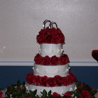 Round Wedding Cake  All flowers are silk to match the brides bouquet. The cakes are all different flavors at the request of the bride and groom with...