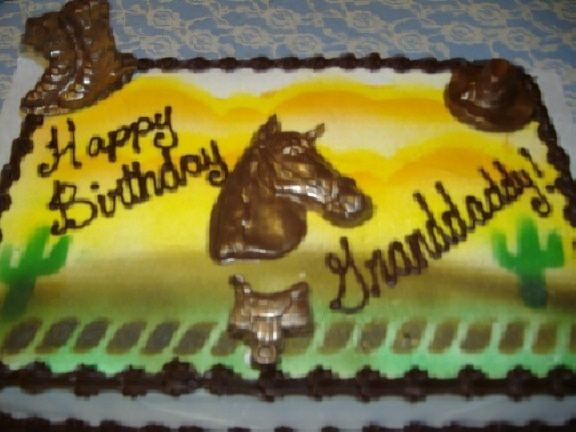 Western/horse Iced in buttercream and airbrushed. Horse, saddle , boots and hat all molded from chocolate candy melts. Iced with chocolate icing border