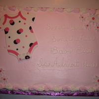 Onsie For Baby Shower   Baby Shower cake with buttercream frosting and fondant decorations