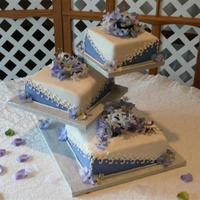 Pedestal Wedding Cake With Hydrangeas  This was my first real fondant wedding cake...I did a cake dummy last year for the fair. The bride really liked the layout...thank you to...