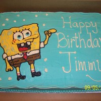 Spongebob Squarepants   Half sheet cake, yellow with buttercream icing. Spongebob drawn freehand in buttercream. TFL.