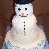 Snowman This was for a child's first birthday. Chocolate cake with bc icing. The blue writing and snowflakes are melted candy wafers. TFL.
