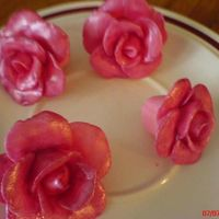Dsc00352.jpg firts time making fondant roses..i painted it with cotton candy sparkle dust...i used this for the xtening cake i made in my gallery..