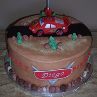 Lightning Mcqueen For Diego's Birthday! Chocolate cake, banana cream filling and banana BC. Special request from the birthday boy's Dad. Lightning McQueen made with RKT,...