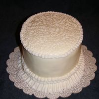 Cornelli - Ruffle Practice  This cake was just for practice. I've only ever done Cornelli lace on a practice board. It was much more challenging on a cake. My...