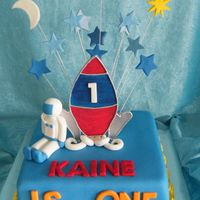 Rocketman   10 inch square , white mud iced in fondant , stand up fondant (with cmc) rocket , fondant astronaut,