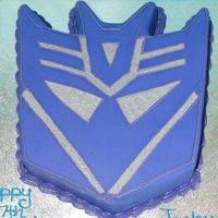 Deceptacon 12 inch square cut to shape and iced in purple