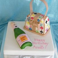 Bag And Champers cast of champers bottle (no cake) 3d small bag cut from 7 inch squaresitting on 15 inch squaremud cakes