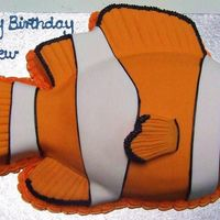 Nemo football tin and 6 inch square used to make all the fins, iced in fondant , choc mudcake
