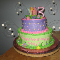 "Tinkerbell Cake For a little girl turning 3....10"" and 7"" rounds iced in buttercream. Flowers are MMF. The stars and the number 3 are gumpaste...."